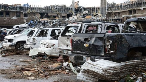 Destroyed vehicles in the parking lot of the wrecked Moore Hospital. Photograph: Gene Blevins/Reuters