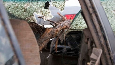 A tree branch driven through a car windscreen in Moore. Photograph: Richard Rowe/Reuters