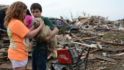 Abby Madi (left) and Peterson Zatterlee comforts Zaterlee's dog Rippy in the wake of the disaster. Photograph: Gene Blevins/Reuters