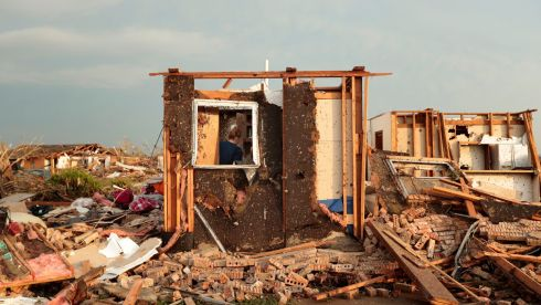 Dana Ulepich searches a room left standing at the back of her demolished house. Photograph:  Brett Deering/Getty Images