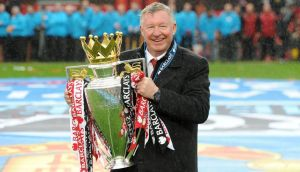Manchester United manager Sir Alex Ferguson celebrating with the Barclays Premier League trophy.  Photograph: Martin Rickett/PA Wire.