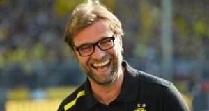 Borussia Dortmund head coach Jürgen Klopp laughs prior to the recent Bundesliga match against Bayern Munich in Dortmund. Photograph; Odd Andersen/AFP Photo/Getty Images