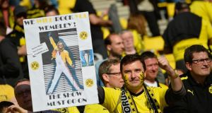 A Dortmund fan holds up a poster of head coach Jürgen Klopp prior to the Bundesliga encounter with Bayern Munich in Dortmund on May 4th. Photograph: Odd Andersen/AFP Photo/Getty Images