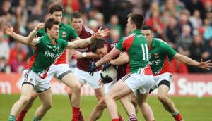 Galway's Gary Sweeney is put under  pressure from Mayo's Enda Varley, Alan Freeman, Cathal Carolan and Cillian O'Connor during last Sunday's match at Pearse Stadium, Galway. 'Mayo forwards will dog any defender coming out with the ball.' Photograph: Inpho