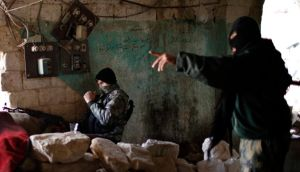 Fighters from Islamist Syrian rebel group Jabhat al-Nusra on the front line during a clash with Syrian forces loyal to President Bashar al-Assad. Photograph: Ahmed Jadallah/Reuters  Files (SYRIA - Tags: CIVIL UNREST POLITICS