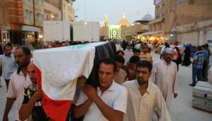 Relatives carry the coffin of an Iraqi police officer killed by militants in Najaf on Monday. Photograph: Ahmad Mousa/Reuters