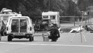 A police photographer at the scene of the 1982 car bomb in Rotton Row, Hyde Park, London. The blast killed and injured a party of cavalrymen on their way to the guard changing ceremony in Whitehall, after an IRA bomb exploded as the Household Cavalry was passing. Photograph: PA News/PA Wire