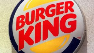 The Burger King logo hangs outside a Burger King restaurant