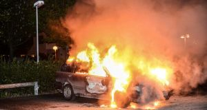 A car set on fire burns, following riots in the Stockholm suburb of Kista. Sweden's capital has been hit by some of its worst riots in years after youths scorched dozens of cars, attacked a police station and threw stones at rescue services in its poor immigrant suburbs for a third night running. Photograph: Fredrik Sandberg/Scanpix/Reuters