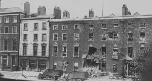 British Lancia armoured police vehicles outside the wreckage of the Hammond Hotel in O'Connell Street, Dublin during the Civil War in July 1922. Photograph: Brooke/Topical Press Agency/Getty Images