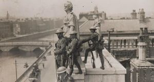 British soldiers keep watch over the banks of the Liffey from a rooftop vantage point.
