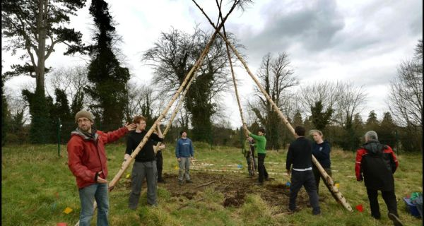 Dr Graeme Warren, a lecturer in UCD's school of archaeology, with students replicating a Mesolithic hunter/gatherer house.