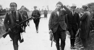 A prisoner under escort  in Munster during the  Civil War. Photograph: National Library of Ireland