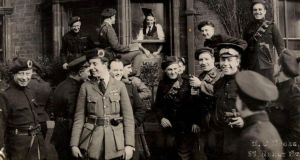 Black and Tans and Auxiliaries in a happy mood after surviving an attack on their Dublin hotel in which an attacker was killed.