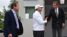Sergio Garcia emerges from a meeting in the rules office with George O'Grady, chief executive of the European Tour (left) and Tim Finchem, PGA Tour Commissioner (right) at Wentworth today. Photograph: Andrew Redington/Getty Images