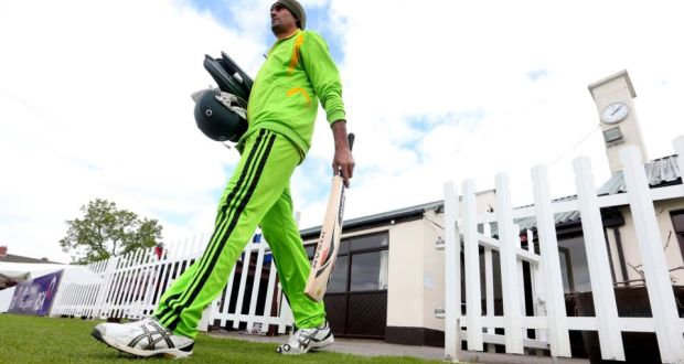 Pakistan's 7ft 1in opening bowler Mohammad Irfan walks out to train at Castle Avenue in Clontarf. Photograph: James Crombie/Inpho