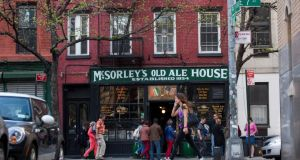 Pedestrians pass McSorley's Old Ale House, in New York City. Photograph: Michael Nagle Pedestrians pass McSorley's Old Ale House. Photograph: Michael Nagle