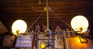 A gas lamp with wishbones said to be hung by World War I doughboys hangs over the bar. Photograph: Michael Nagle