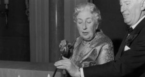 Agatha Christie cuts a cake at a party to celebrate the 10th anniversary of 'The Mousetrap'. Photograph: Len Trievnor/Express/Getty Image
