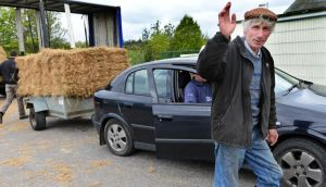 Tom Joe McManus, Drumshanbo, collecting fodder brought in from Brighton, England, and distributed to farmers affected by the fodder shortage, at Kiltoghert Co-Op, Co Leitrim on Wednesday. Photograph: Eric Luke