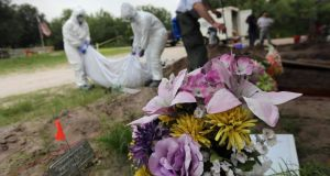 A forensic anthropology team unearths the remains of unidentified immigrants from a cemetery  in Falfurrias, Texas. Teams from Baylor University and the University of Indianapolis are exhuming the bodies of more than 50 immigrants who died, mostly from heat exhaustion, while crossing illegally from Mexico into the United States. Photograph: John Moore/Getty Images