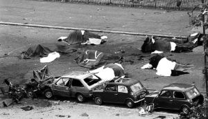 Dead horses covered up and wrecked cars at the scene of carnage in Rotten Row, Hyde Park, after an IRA bomb exploded as the Household Cavalry was passing. John Anthony Downey, 61, has been charged with the murders of four soldiers in the bombing.