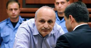 Former Georgian prime minister Ivane Merabishvili (C) listens to his lawyer during a preliminary hearing of his case. Photograph: Irakli Gedenidze