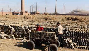 Brick layers work at a brick factory on the outskirts of Giza governorate in Egypt. Photograph: Asmaa Waguih/Reuters