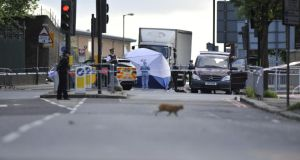 Police at the scene where a man was murdered in John Wilson Street, Woolwich, south London. Photograph:  Nick Ansell/PA Wire