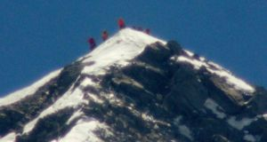 A team of climbers, including 80-year-old Japanese mountaineer Yuichiro Miura, stand on the summit of Mount Everest this morning. Photograph: Kyodo/Reuters