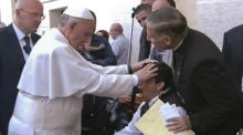 """The 'exorcism' lasted 10 seconds. When Pope Francis arrived, he immediately rested his left hand on the young man's head and spoke with a priest standing behind the wheelchair. The young man kissed the pope's ring, suggesting that the devil was not in total control."" Photograph: AP/APTN"