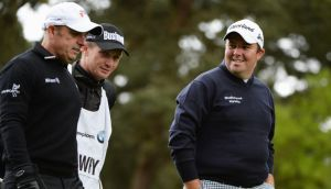 Paul McGinley (left) and Shane Lowry (right) chat way during the first round of the BMW PGA Championship on the West Course at Wentworth. Photograph: by Ross Kinnaird/Getty Images.