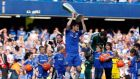 Chelsea's Frank Lampard  holds the Europa League trophy aloft at Stamford Bridge. Photograph: Stefan Wermuth/Reuters