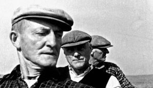 A 1972 photograph of Sean 'Faeilí' Ó Catháin (front) and Maidhc 'Léan' Ó Guithín (back): two of the three cousins who rowed across Blasket Sound in a storm in 1947 to get a coffin for the deceased Seán Ó Ceárna. The man in the middle is Seán Ó Guithín. Photograph: From the Great Blasket to America – The Last Memoir by an Islander, published by the Collins Press