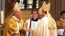 "Episcopal Ordination of Eamon Martin as Coadjutor Archbishop of Armagh by Cardinal Seán Brady at Saint Patrick's Cathedral, Armagh, last month. ""Archbishop Martin would appear to be operating with a 19th century devotional understanding of the Eucharist that is both private and personal."" Photographer: Dara Mac Dónaill"