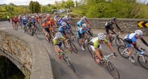 The peleton crosses the bridge in Kealkill, Co Cork, during stage 5 of the An Post Rás from Glengarriff to Mitchelstown. Photograph: Sportsfile