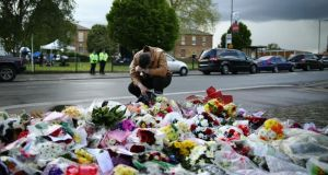 A man pays his respects outside Woolwich Barracks in London yesterday. Photo by Dan Kitwood/Getty Images