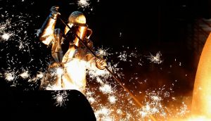 File photograph of a worker  controlling  a blast furnace at Europe's largest steel factory  in the western German city of Duisburg. Germany's economy crept back into growth in the first quarter of the year after a sharp contraction at the end of 2012. Photograph: Ina Fassbender/Reuters.