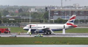 A British Airways plane surrounded by emergency vehicles after it had to make an emergency landing at Heathrow airport. Photograph:  Steve Parsons/PA Wire