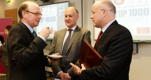 (Left to right) Irish Times editor Kevin O'Sullivan, Irish Times business editor John McManus and  KPMG managing partner Shaun Murphy at the publication of the Irish Times Top 1,000 companies magazine in Dublin today. Photograph: Cyril Byrne.