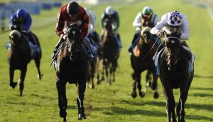 Kevin Manning (right)  takes the Autumn Stakes at Newmarket aboard Trading Leather