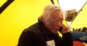 Yuichiro Miura: rests in a camp at 8,000m (26,247ft) during his attempt to scale Mount Everest.  Photograph: Miura Dolphins/AP