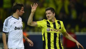Robert Lewandowski celebrates after scoring a penalty against Real Madrid to make it 4-1 in the Champions League semi-final first leg. Photograph: John MacDougall/AFP/Getty Images