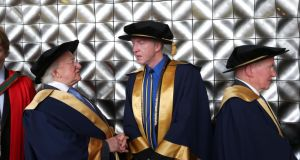 President Michael D Higgins chatting with Milliner/designer Philip Treacy who were conferred with Honorary Fellowships from GMIT at a ceremony in Galway yesterday. Photograph: Joe O'Shaughnessy