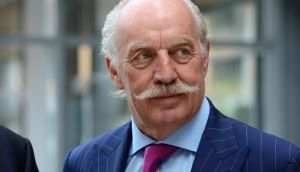 Dermot Desmond, speaking at the National College of Ireland, said: 'The manner in which we elect our politicians is not fit for purpose.' Photograph: Cyril Byrne