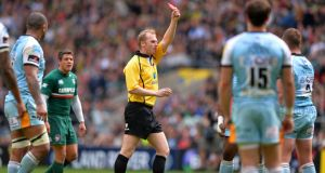 Referee Wayne Barnes shows the red card to Dylan Hartley of Northampton during the Aviva Premiership Final against  Leicester  at Twickenham. Photograph: Mike Hewitt/Getty Images