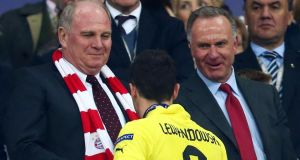 President of Bayern Munich Uli Hoeness (left) offers his commiserations to Robert Lewandowski of Borussia Dortmund after losing the Uefa Champions League Final at Wembley Stadium. Photograph: Alex Grimm/Getty Images