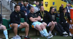 Dylan Hartley (centre), the Northampton captain sits on the bench after being sent off during the Aviva Premiership final between Leicester Tigers and Northampton Saints at Twickenham Stadium on Saturday. Photograph:   David Rogers/Getty Images