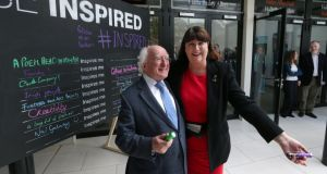 "President Michael D Higgins and EU Máire Geoghegan-Quinn, European commissioner for research, innovation and science, after writing what inspires them at the Coimbra conference at NUI Galway. President Higgins wrote: ""Good company""; and Ms Geoghegan-Quinn wrote: ""Family"".  Photograph: Joe O'Shaughnessy"
