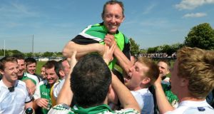 London manager Paul Coggins is carried by the jubilant team members after their famous victory. Photograph: Jim Keogh/Inpho